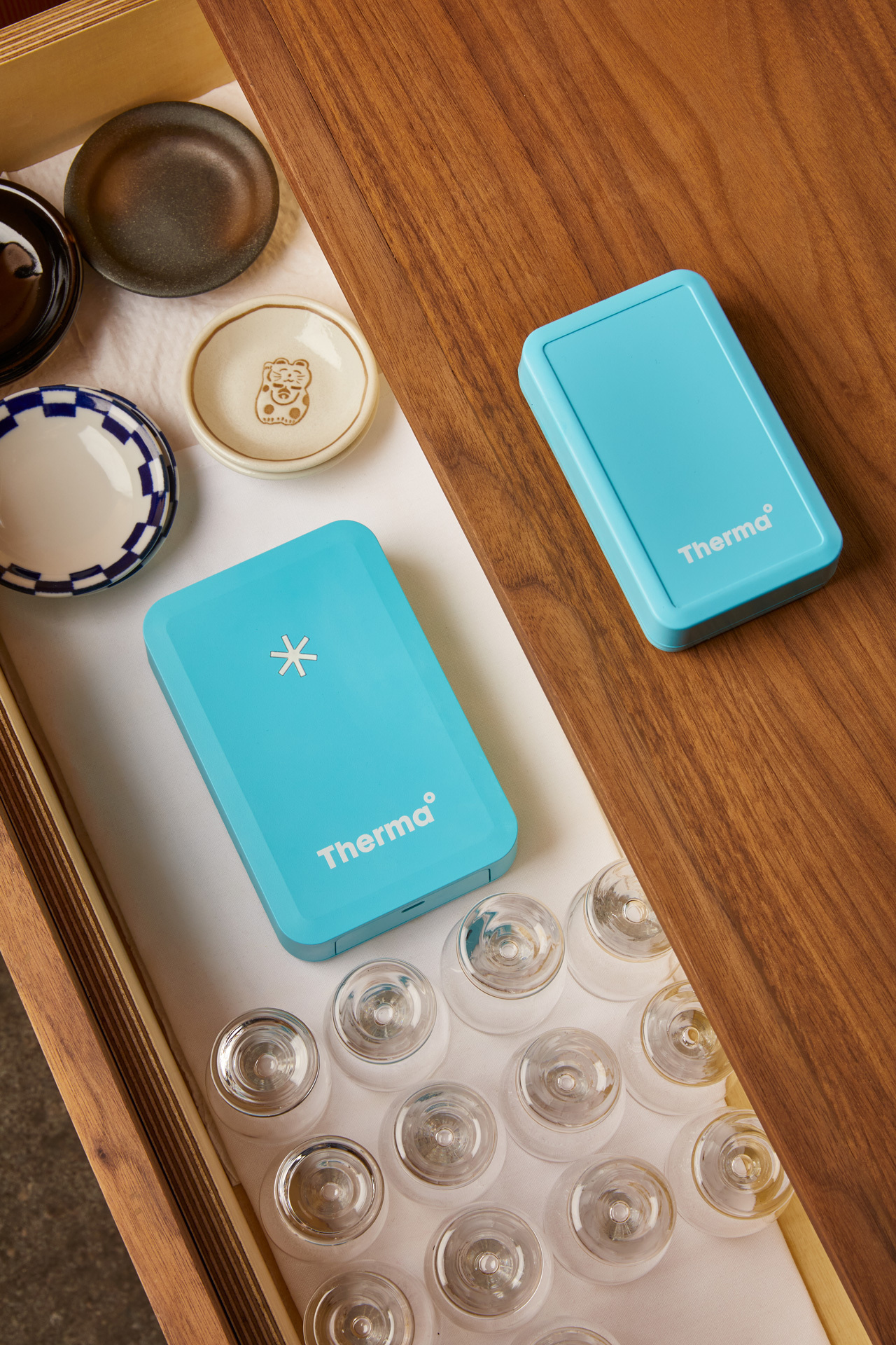Therma hub and Therma temperature and humidity sensor on table